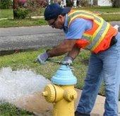 man flushing a hydrant