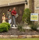 couple walking into open house in Mesquite