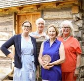 Historic Mesquite employees pose with award