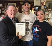 Mesquite BBQ owners pictured with Mayor Pickett
