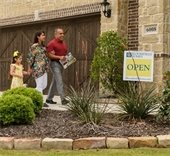 family walking into open house in Mesquite
