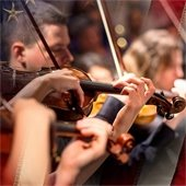 Violinists playing in Mesquite Symphony Orchestra