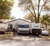 RV and large trucks parked in driveway