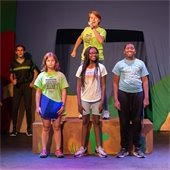 children on stage at missoula camp