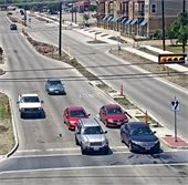 cars at stoplight, road report