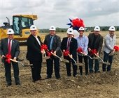 City Council, City Manager and Iron Horse developers posed with ground breaking shovels, wearing hard hats
