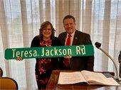 Mayor Pickett presenting road sign to Teresa Jackson