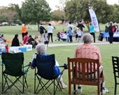 Community members sitting in lawn chairs during previous National Night Out event