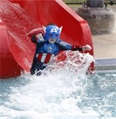Kid dressed up in a Captain America takes the polar plunge