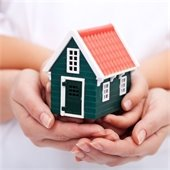 toy house in palm of hands