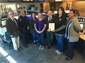 Mayor Pickett pictured with Chief Cato and group of Mesquite public safety dispatchers