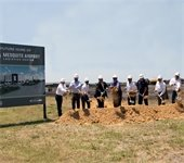 Groundbreaking ceremony, group throws dirt from shovels