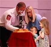 lt jacob heise rings ceremony bell with wife amelia and kids