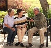 senior sitting together on a bench