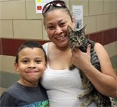 Mom and her son with their new cat they just adopted