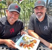 Alejandros owners with plate of food