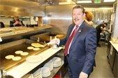Mayor Pickett flipping pancakes