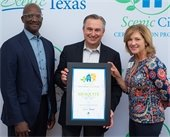 City Manager Cliff Keheley pictured receiving Scenic City award