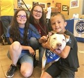 kids with dog they adopted