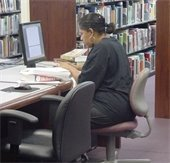 woman uses computer at Mesquite library