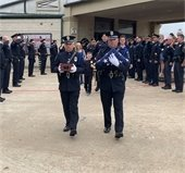 officers salute as K9 Kozmo's ashes are carried to car