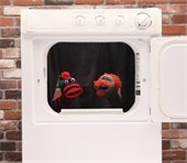 behind the dryer, two socks in a dryer
