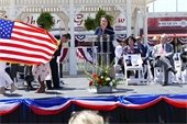 First Lady Cecilia Abbott at podium during downtown celebration