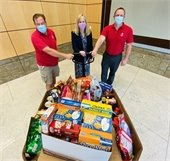 Finance department employees donate t local food pantries