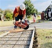 Man cutting through concrete