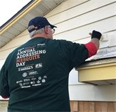 man paints house at Addressing Mesquite Day