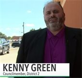 Kenny Green in front of store