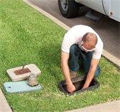 man working on water meter