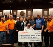 AMBUCS members pictured presenting $10,000 check to City Council