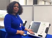 Dallas County representative pictured with new voting equipment