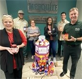 Parks and Rec team with peanut butter and jelly they donated