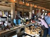 Woman browsing items at previous barn sale