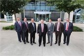 Mesquite City Council members standing side by side in front of City Hall building