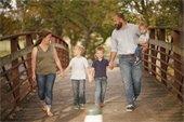 Family walking across a bridge