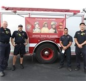 Firefighters next to fire engine on the first day