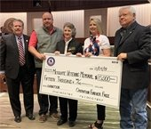 Members of Operation Forever Free pictured with Mayor Stan Pickett holding $15,000 mock check