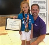 Marlins swimmer Harper Holland pictured with her father
