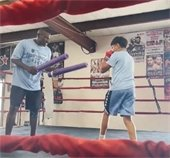 officer and student in boxing ring at camp