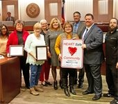 Mesquite Heart Board pictured with Mayor Bruce Archer holding the Heart Safe Community sign