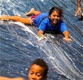 girl sliding on a slip and slide
