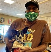 man adopts a dog at clear the shelters event