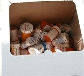 Old pill bottles collected at Drug Take Back Day