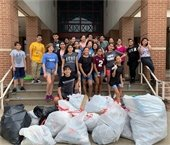 Young trash bash volunteers pictured with bags of trash collected