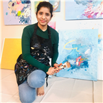 Artist Deepa Koshaley poses with her artwork