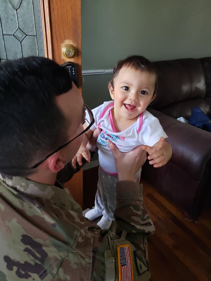 Sgt. Matthew Taylor with baby, Lily after returning home to Mesquite, wife Amanda Taylor