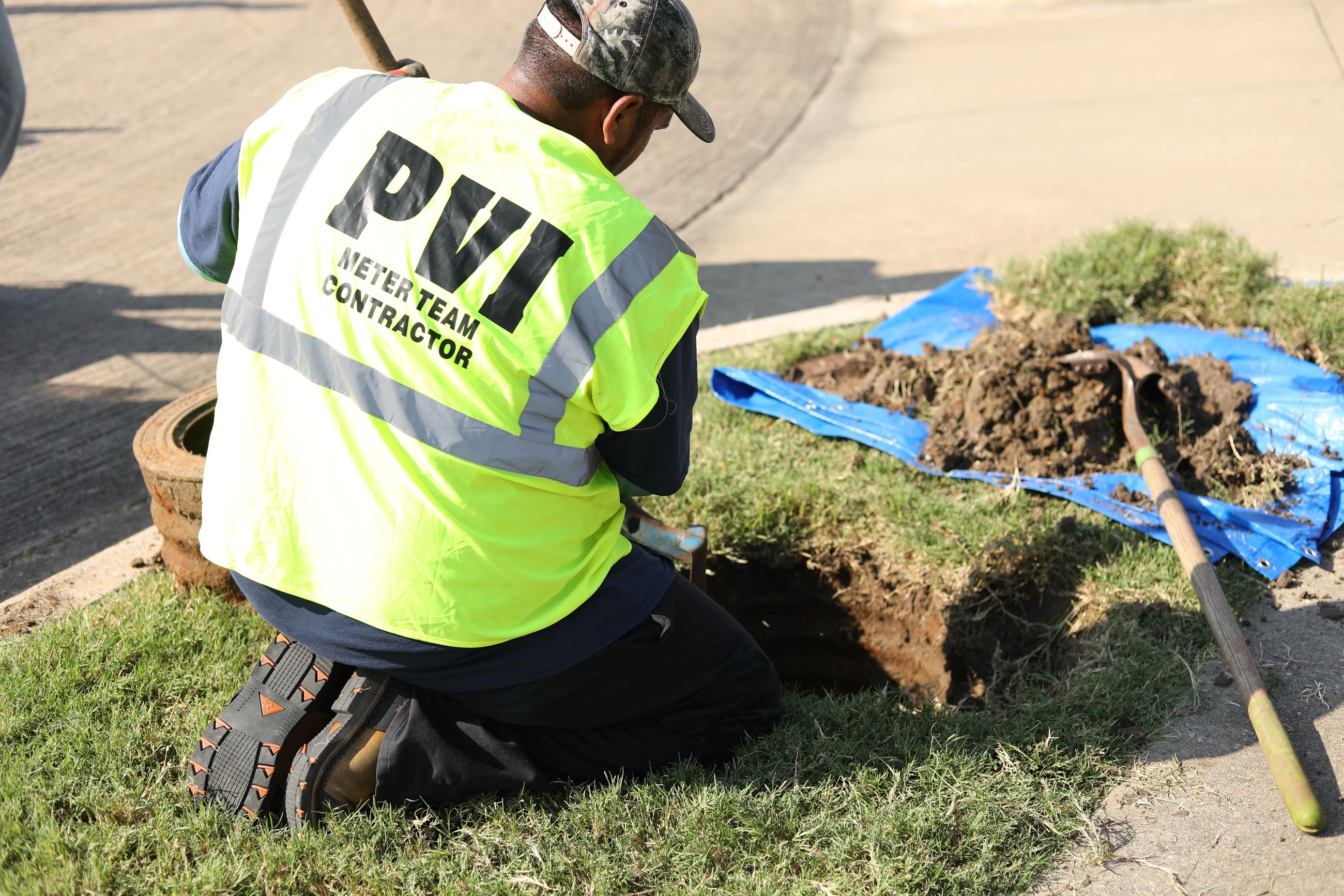 PVI worker installs meter